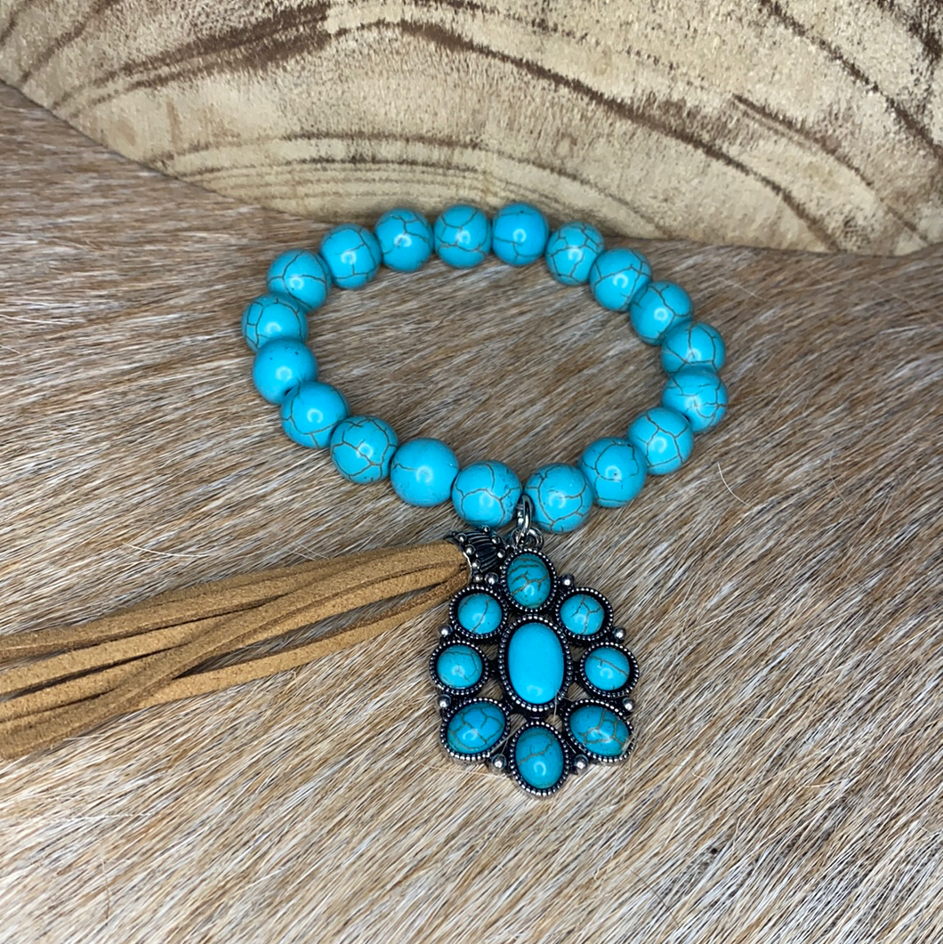 SINGLE TURQUOISE STRETCH BRACELET WITH TURQUOISE CHARM & TASSEL