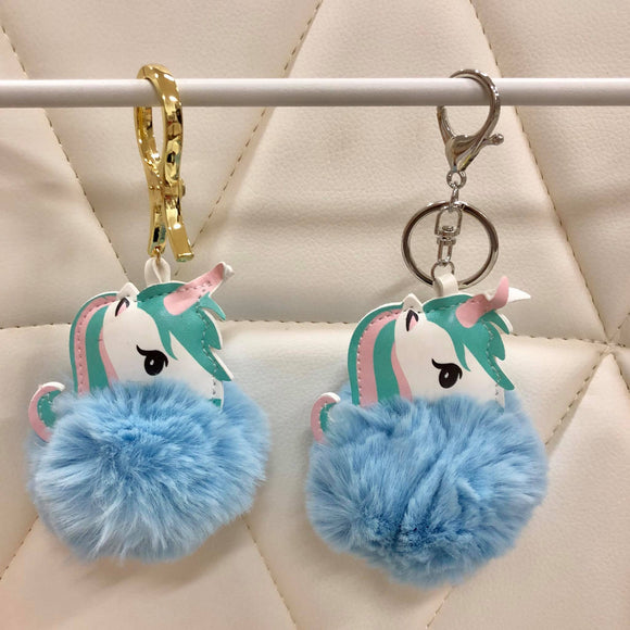 Unicorn with fur ball bag charm by Tomorrow Closet