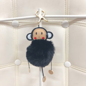Monkey with fur ball bag charm by Tomorrow Closet