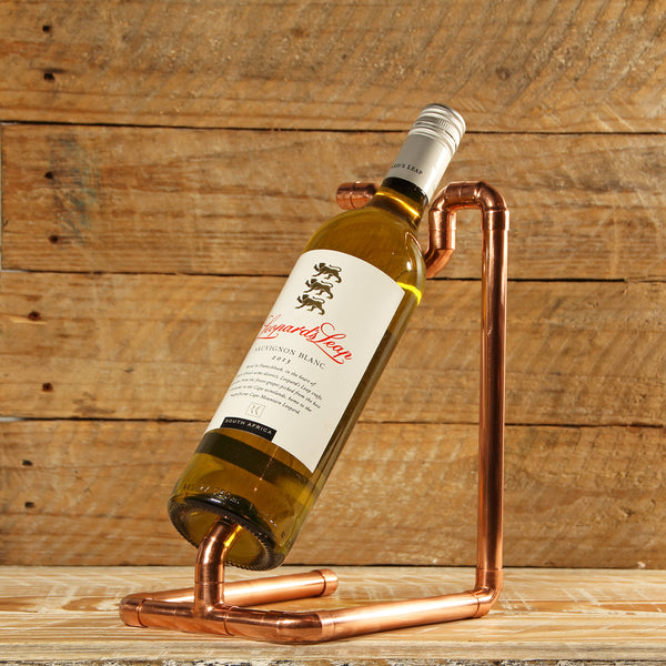 Steampunk inspired copper pipe wine holder for sale in South Africa.