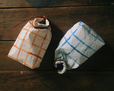 sustainable bags from recycled sails. Handmade in the USA. natural leather.