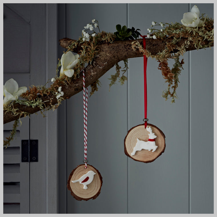 Rustic wooden disc with ceramic detailing Christmas Decorations