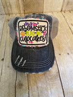"""My Broomstick Runs on Cupcakes"" trucker hat"