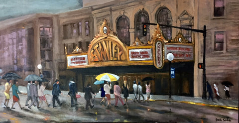Impressionist style image of the Stanley Theater in Journal Square. A rainy day, with people holding umbrellas outside.