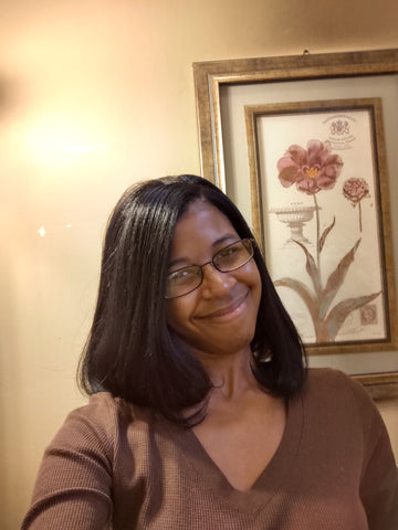 donchellee fulwood young black woman with straight hair and glasses smiling