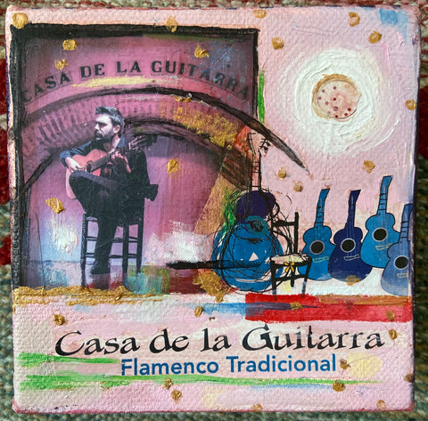 "collaged square canvas with man playing a guitar in top left corner, several blue guitars lining the center of canvas, and text that reads ""Casa de la Guitarra, Flamenco Tradicional"" across bottom"
