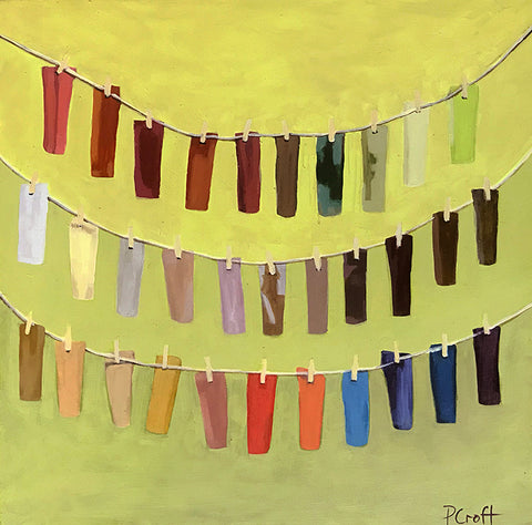 light olive green ombre background with several small color swatches dangling across image as if on a clothesline