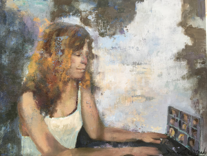 Woman with golden hair sitting at a computer with a textured back round.