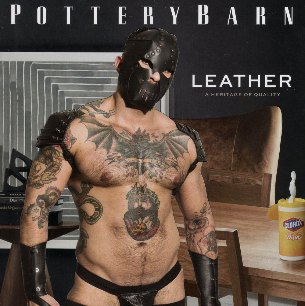 A  half naked man with tattoos wearing a leather mask.