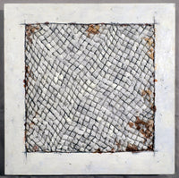 Assemblage piece with white plastic being poked through a grid on a white square made of wax.