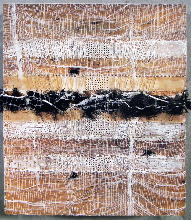 An abstract piece with gause and wax with black feathers all attached to a wood block.