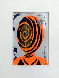 The shape of a human head in orange with purple swirl lines throughout. A three dimensional eye is in the middle of the head.