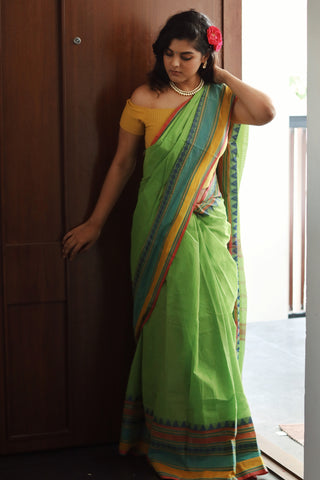 women in a cotton saree standing
