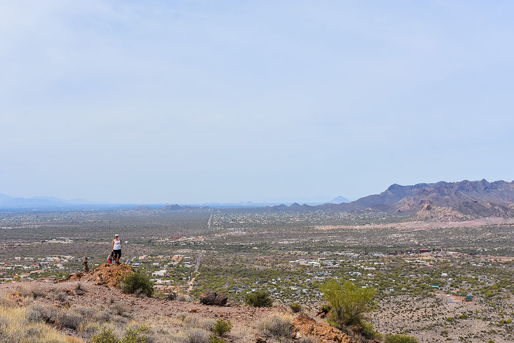 Taking in the view from the top of our hike on the Treasure Loop Trail at the Lost Dutchman State Park, Superstition Mountains, Arizona. Spring Road Trip with Davis Taylor Trading Co.