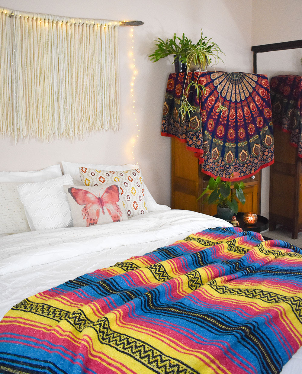 The Sunshine Day Dream blanket looks beautiful in the boho bedroom and adds so much color and warmth.