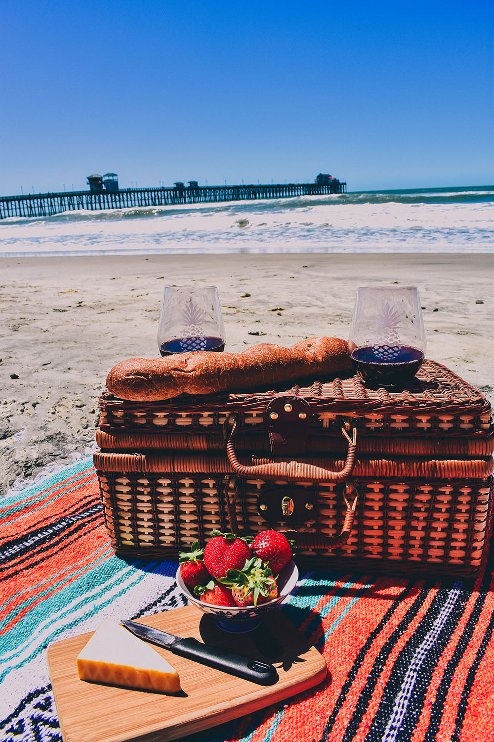 What would summer be with out a little summer lovin? Treat your other half to a romantic outdoor picnic for two. We love a picnic on the beach, basking in the warm sunshine. A good bottle of vino and a few munchies are all you need for a romantic beach rendezvous.