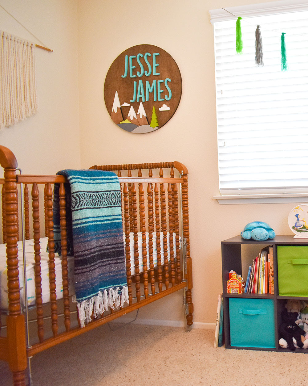 Baby JJ's adventure theme nursery wouldn't be complete with out a Bohemian Fiesta Blanket. It adds a cozy vibe to the room and comes in handy on chilly nights when I'm rocking the baby. Our little guy can take it with him on adventures as he grows older. So cute!