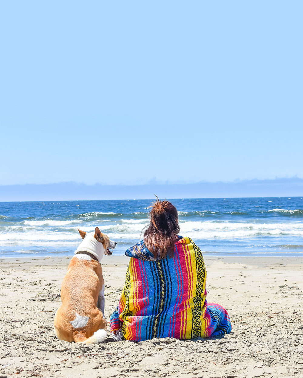 Relaxing at the beach with my best friend and my Sunshine Day Dream blanket. A cozy blanket that I can take anywhere my wanderlust spirit takes me.