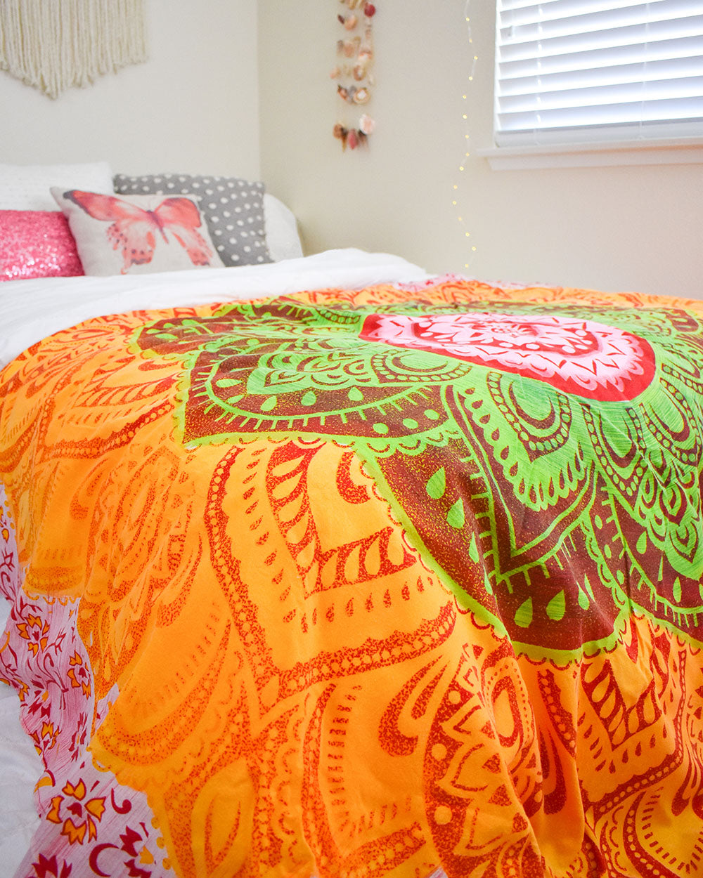 The coolest way to add color and drama to any room is with a tapestry, and the dorm room is no exception. A Boho Roundie can be used in a variety of ways to add color and dimension to your room. Try it on the bed, on the wall, draped over a chair, or even on the floor.