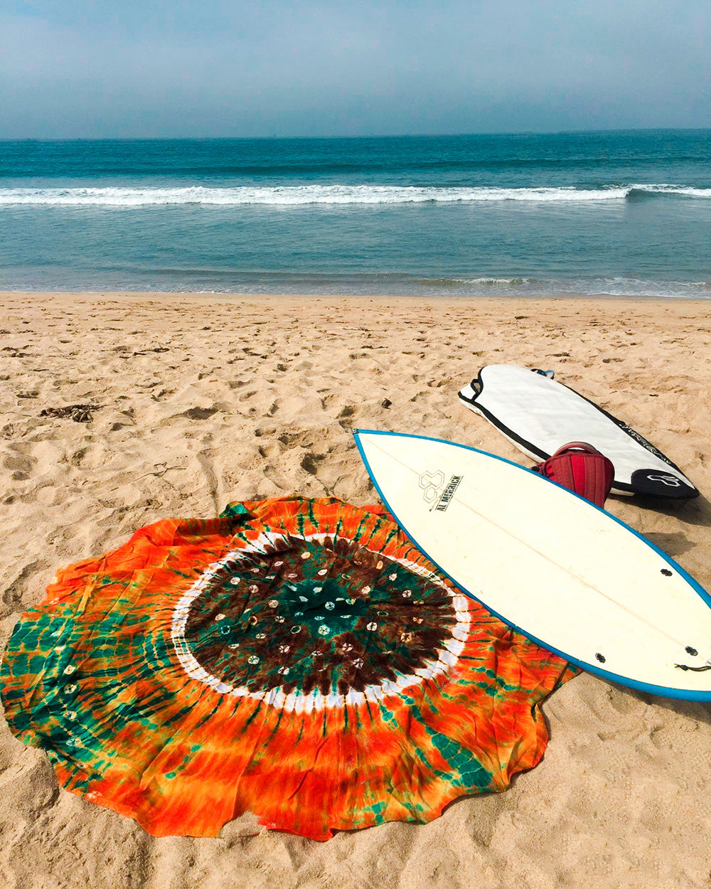 Surfs up with the Earthy Vibes Roundie. A unique beach blanket for the boho soul, hippie girl, or anyone who loves a good pop of color inspired by nature.