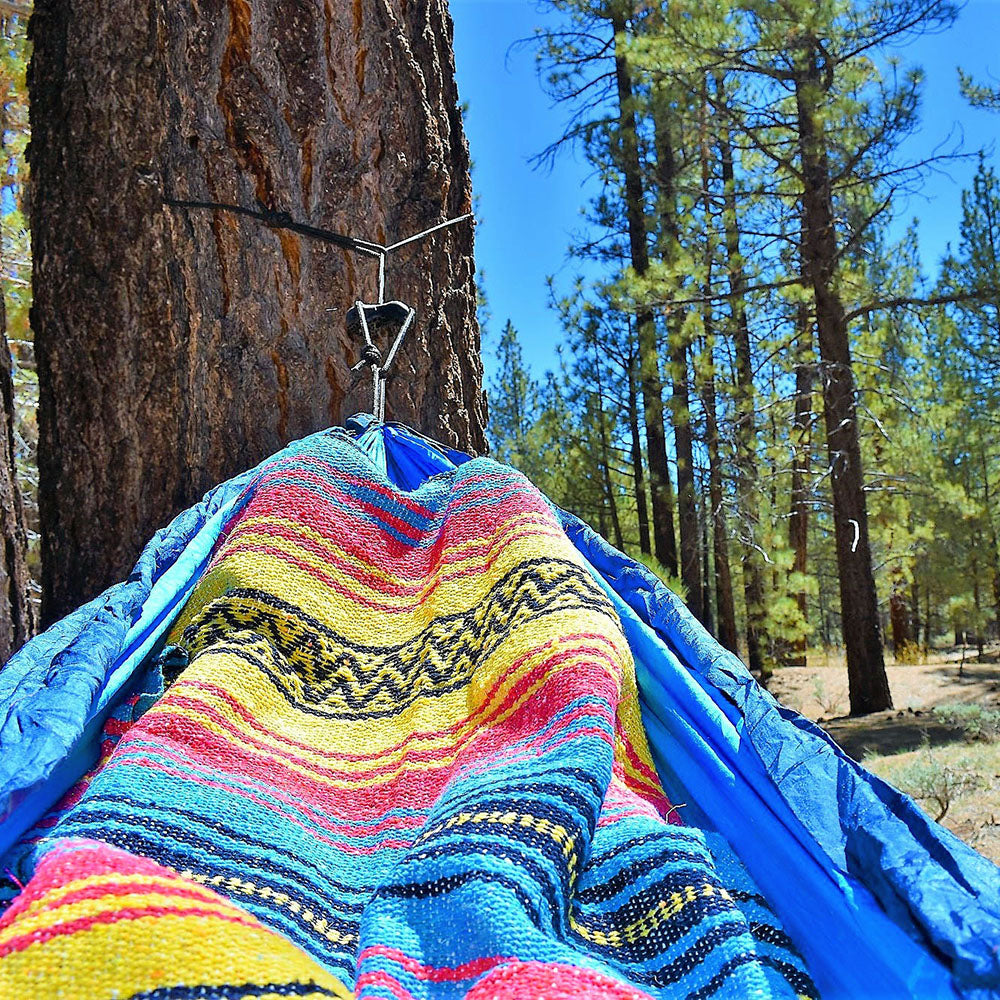 Relaxing in the hammock with my Sunshine Day Dream Mexican Blanket. The perfect boho blanket for all of life's adventures.