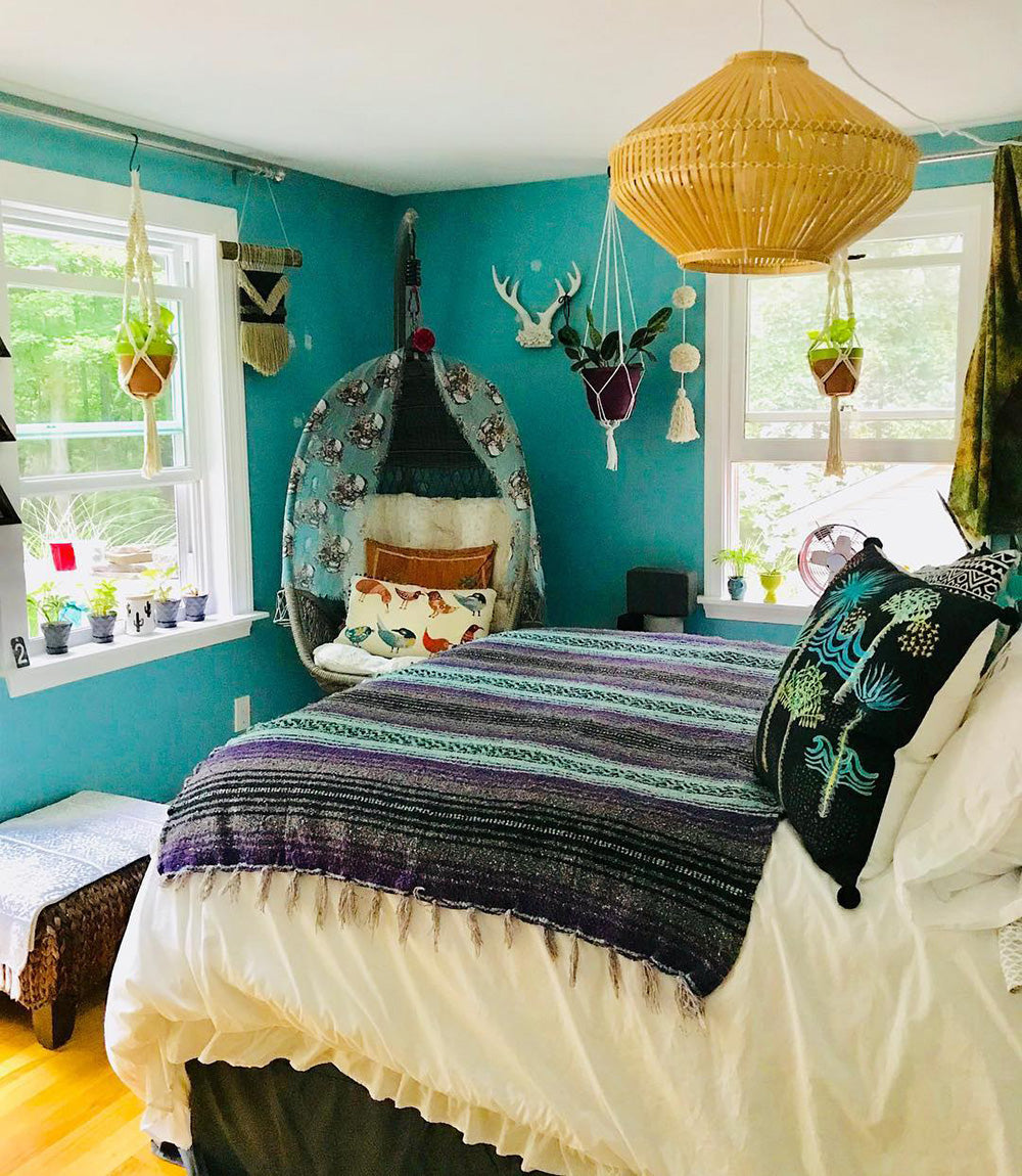 A cozy boho bedroom featuring the Purple Surf Bohemian Fiesta Blanket. These traditional Mexican blankets are perfect for creating a cozy boho look in the bedroom or anywhere else in the home.