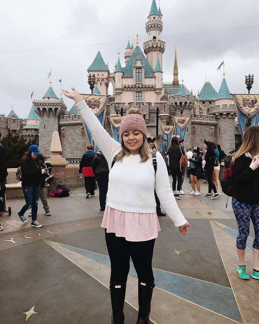 Having a blast at Disneyland on a cold winters day! Rocking the cutest pom beanie to keep my head warm all day long.