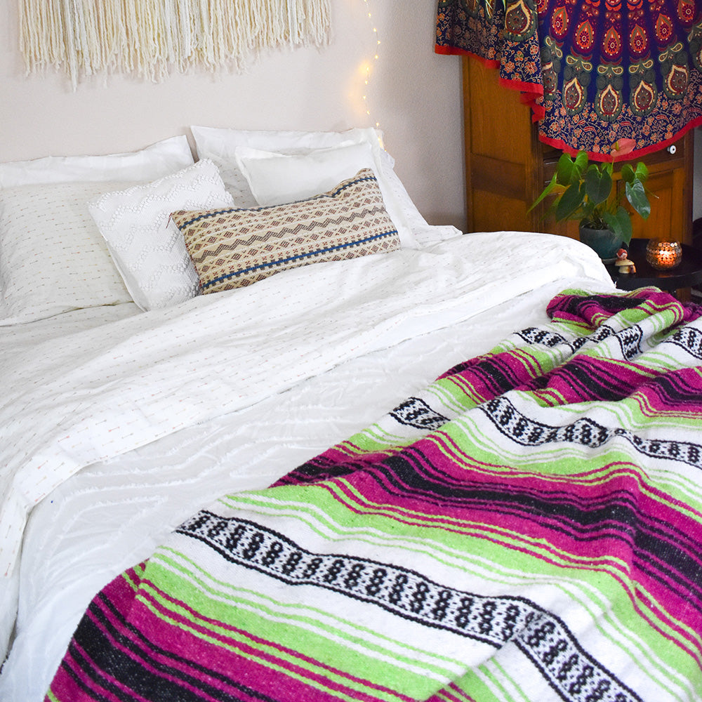 Sleep in with the Neon Candy Bohemian Fiesta Blanket.