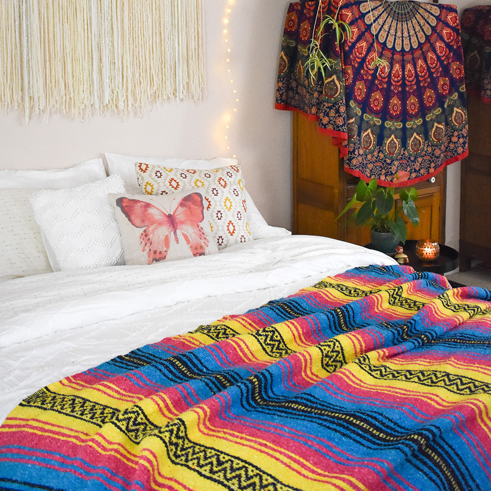 Wake up the bedroom with the bold color of the Sunshine Day Dream Mexican Blanket on the foot of your bed.