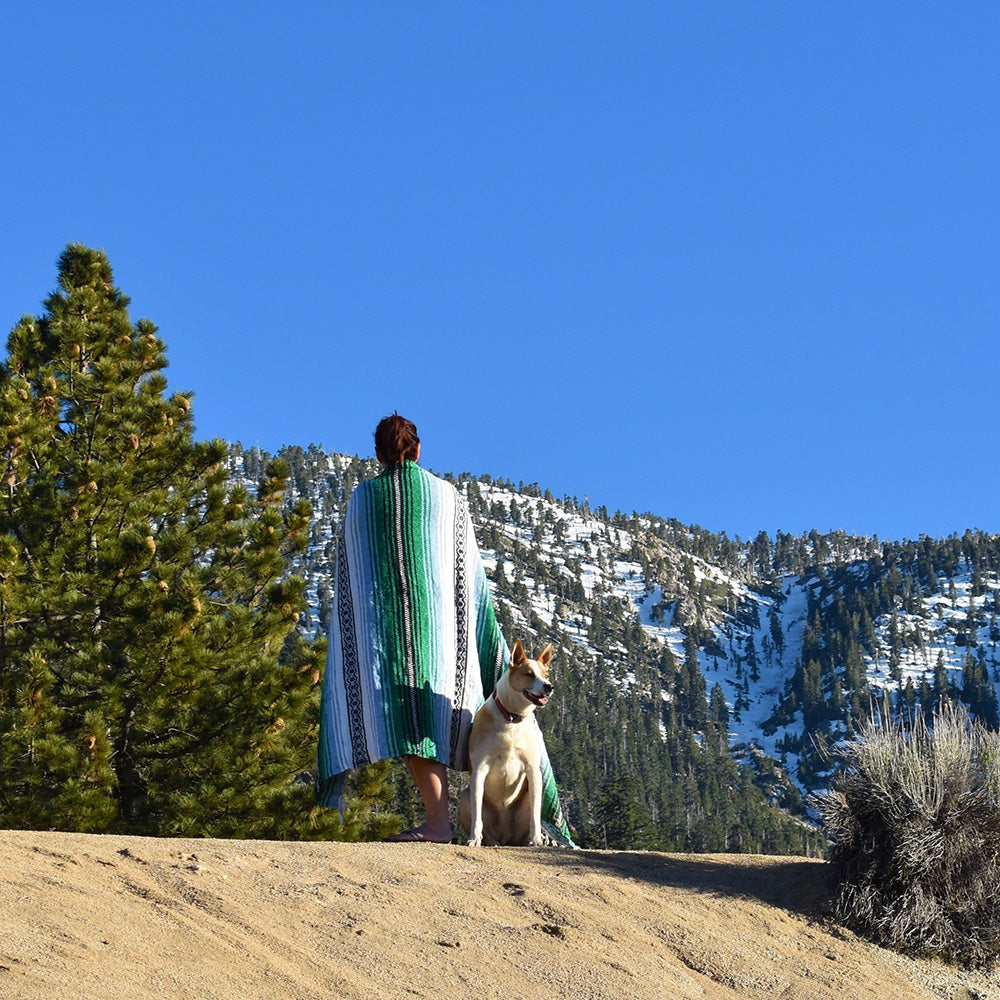 Enjoying the snowy mountain views with the Mountain High Bohemian Fiesta Blanket.