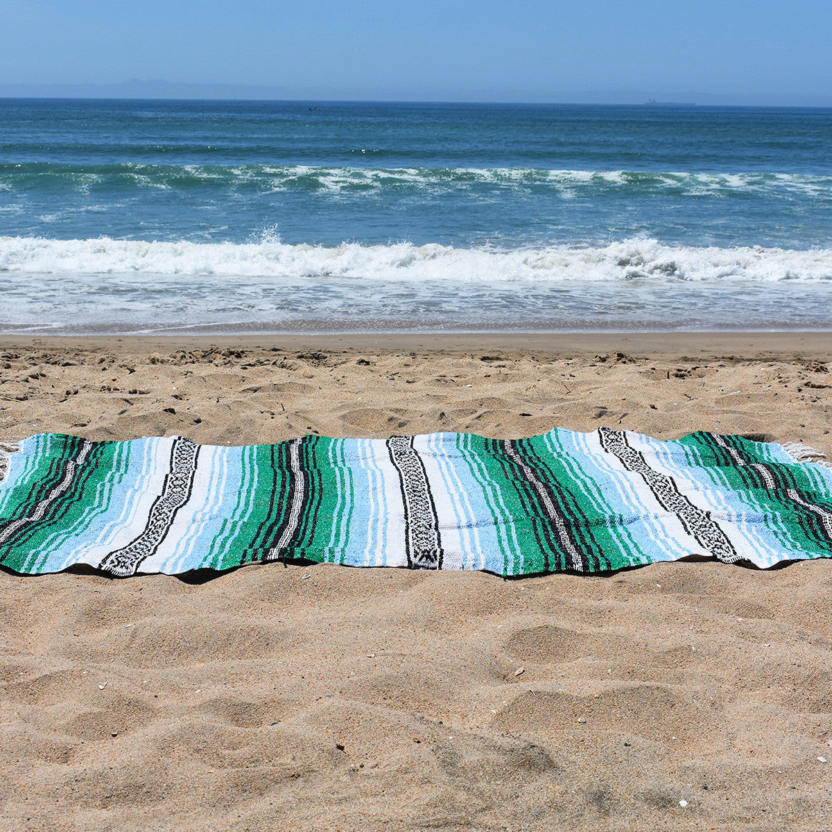 Relax on the beach all summer long with the laid back style of the Mountain High Bohemian Fiesta Blanket.