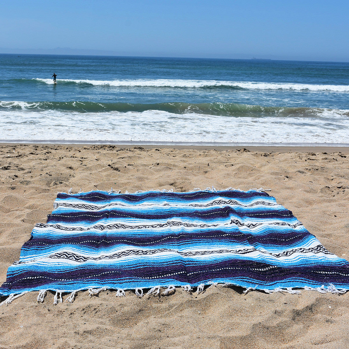 Turquoise Dream Mexican Blanket is perfect for a day at the beach.