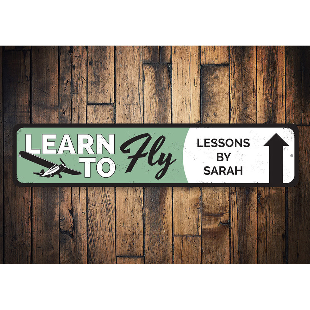 Learn To Fly Arrow Sign Aluminum Sign