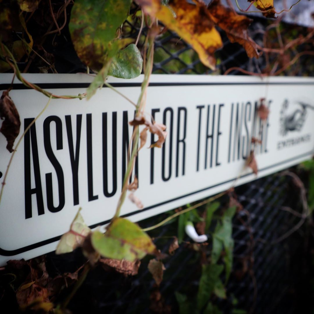 Asylum for the Insane Entrance Sign