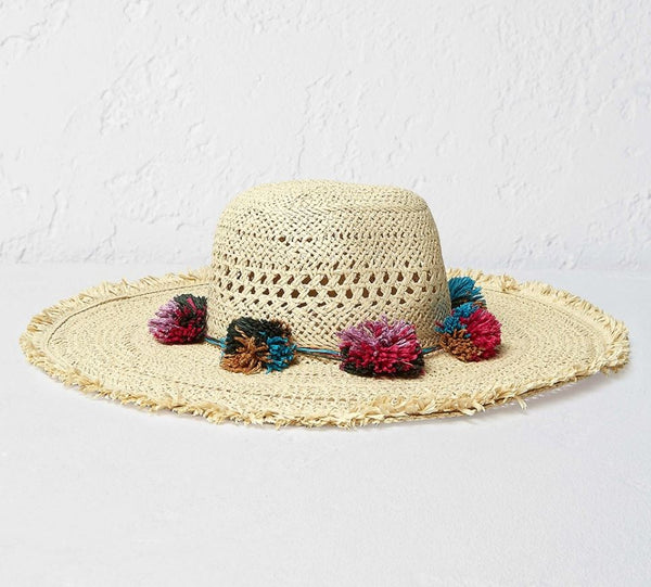 straw hat with colourful pom-poms