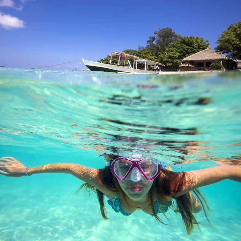 woman swimming half under water