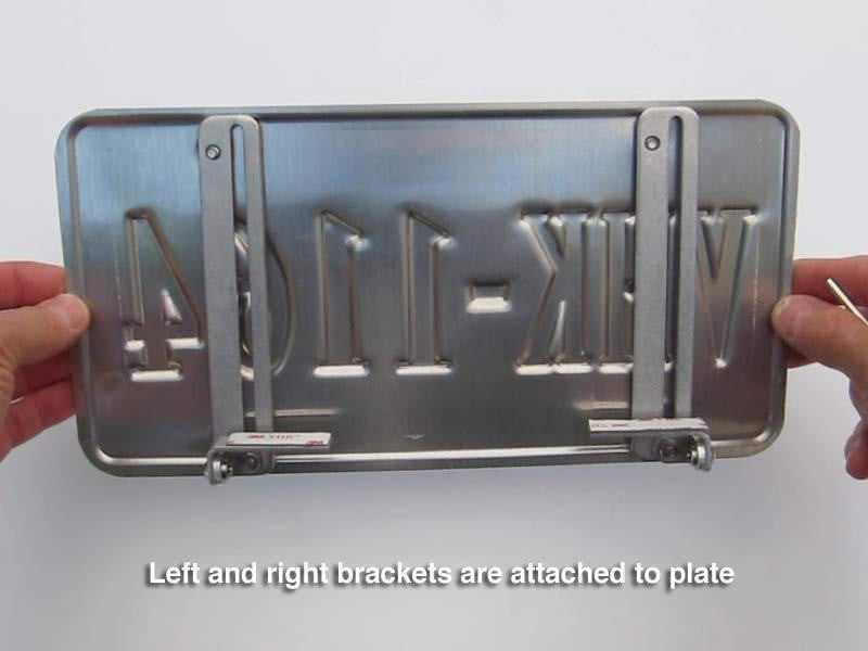 Left and right brackets are attached to plate