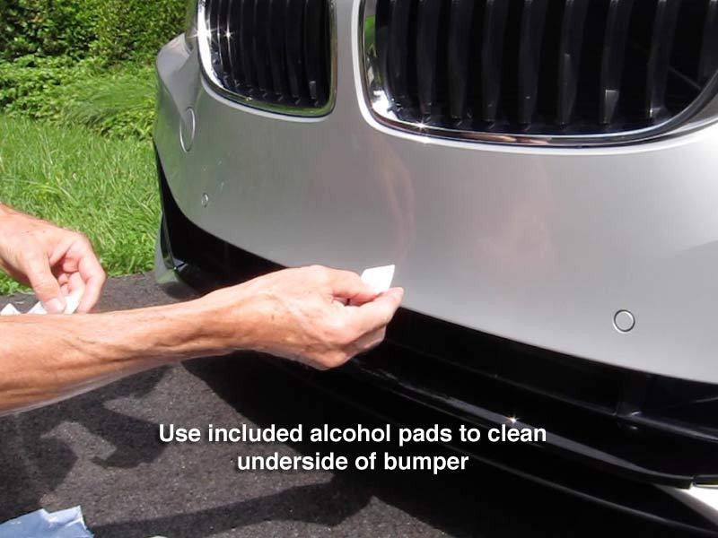 Use included alcohol pads to clean underside of bumper.