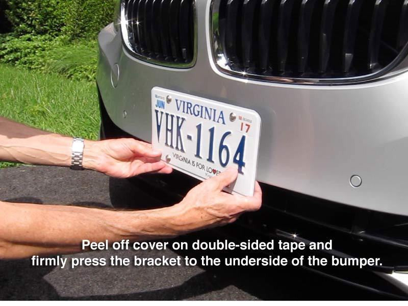 Peel off cover on double-sided tape and firmly press the bracket to the underside of the bumper.
