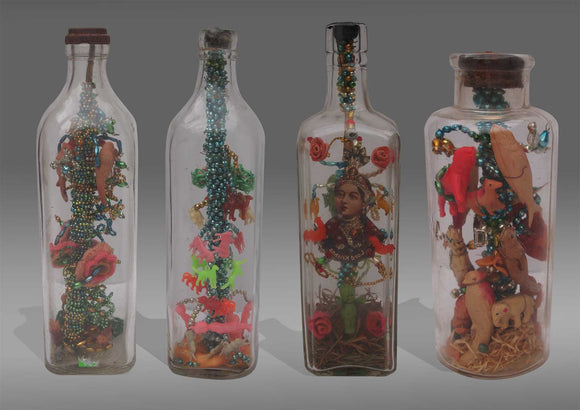 Collection of nine novelty Colonial Cased Bottles