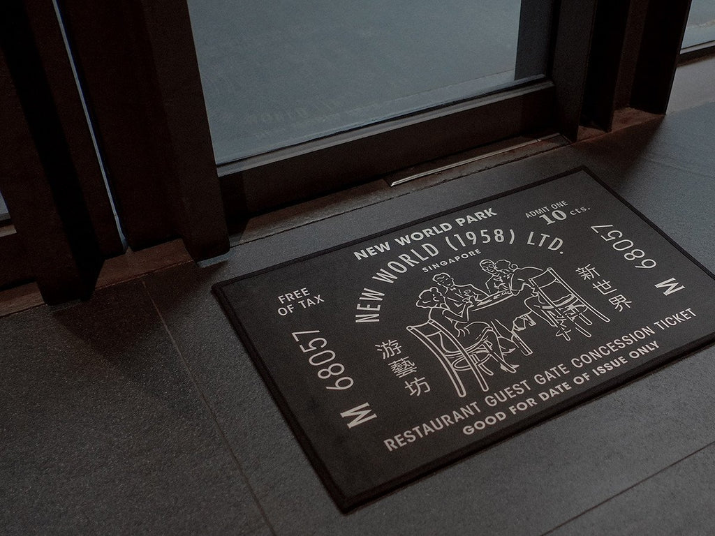 Papan Tanda Door Mat- New World Park