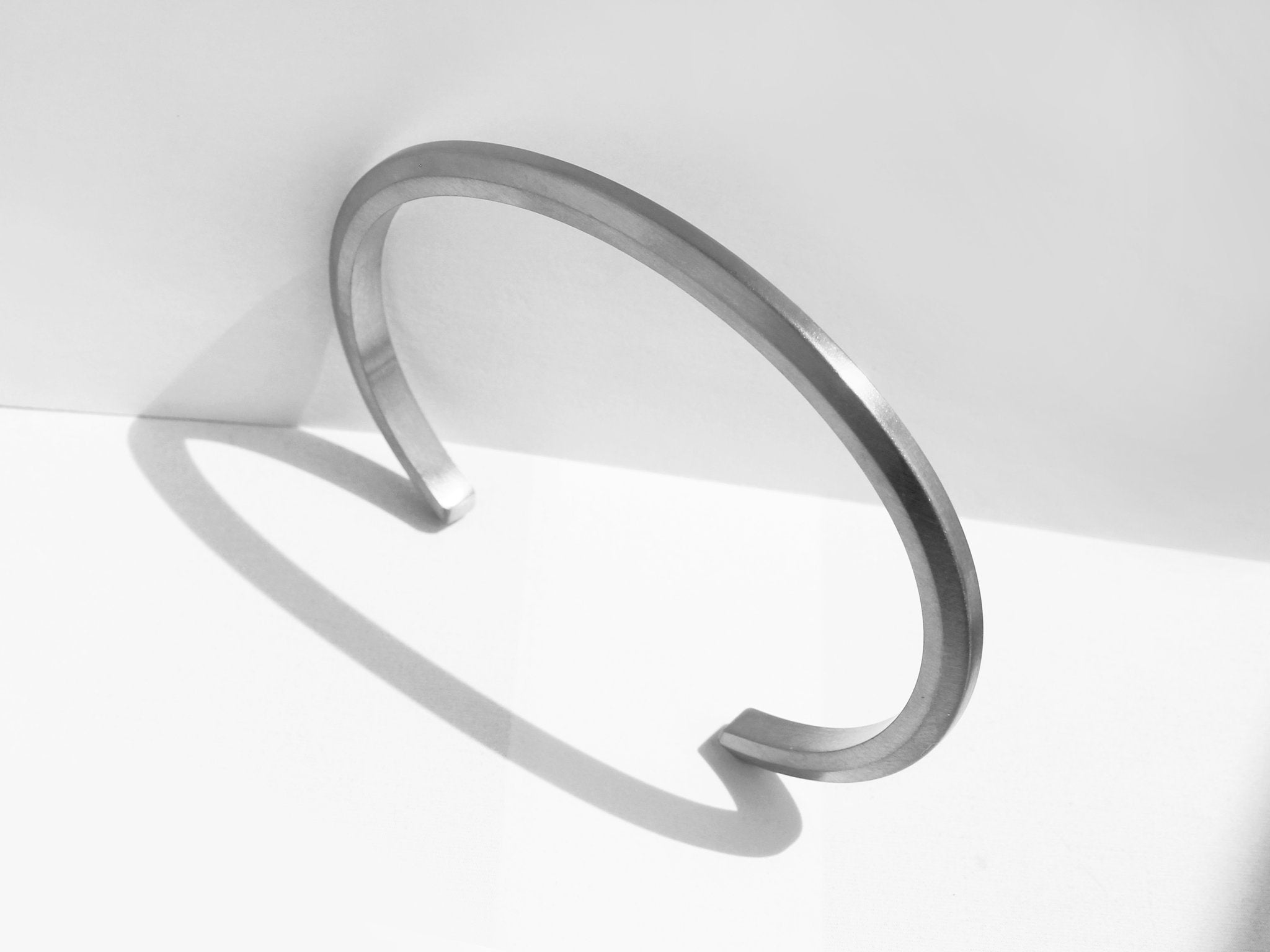 Wide Bevel Cuff Bracelet In Brushed Stainless Steel