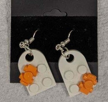 Earrings: Bay Window, white with orange roller skates.