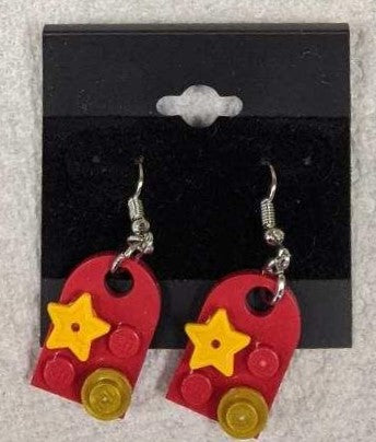 Earrings: Bay Window,  red with yellow stars and gold colored decorations.