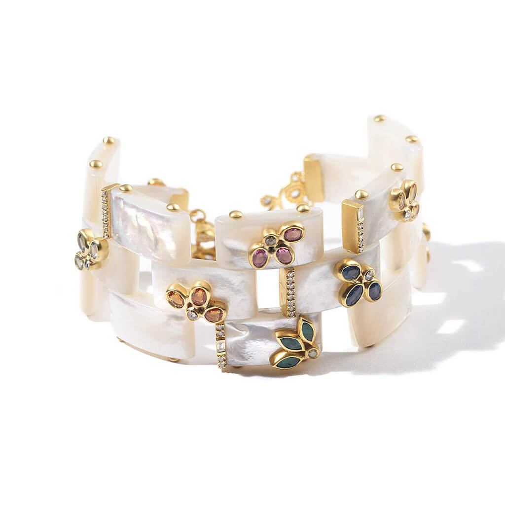 20K Affinity Mother of Pearl Bracelet, $18,500. product:20k-affinity-mother-of-pearl-bracelet