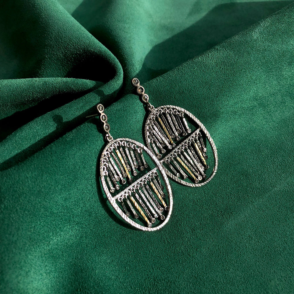 Sterling Silver and Diamond Dream Catcher Earrings, $530. product:sterling-silver-double-layer-stick-earrings