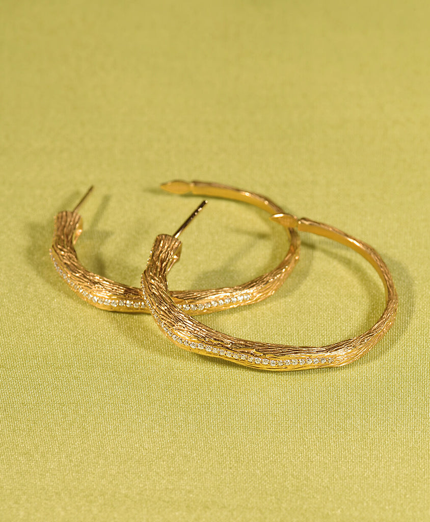 20K Vitality Branch Diamond Hoop Earrings, $4,000. product:20k-serenity-diamond-hoop-earrings-large