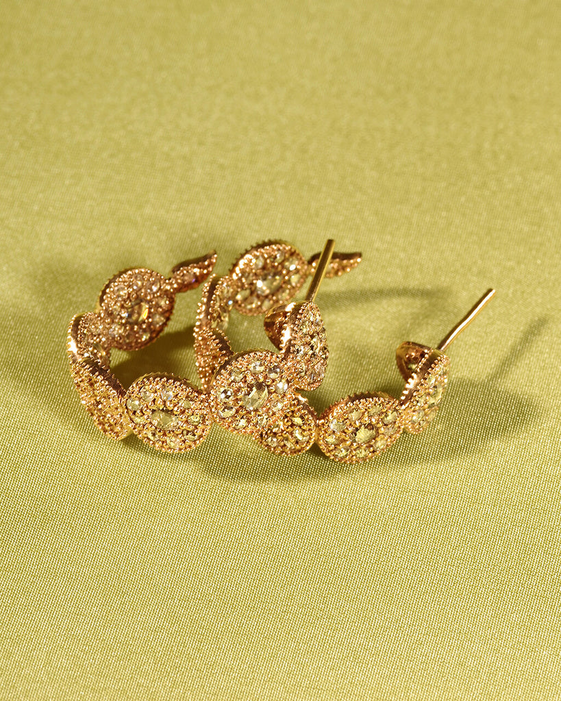 20K Yellow Gold Eternity Opera Small Hoop Earrings, $4,500. product:eternity-opera-20k-yellow-gold-small-hoop-earrings