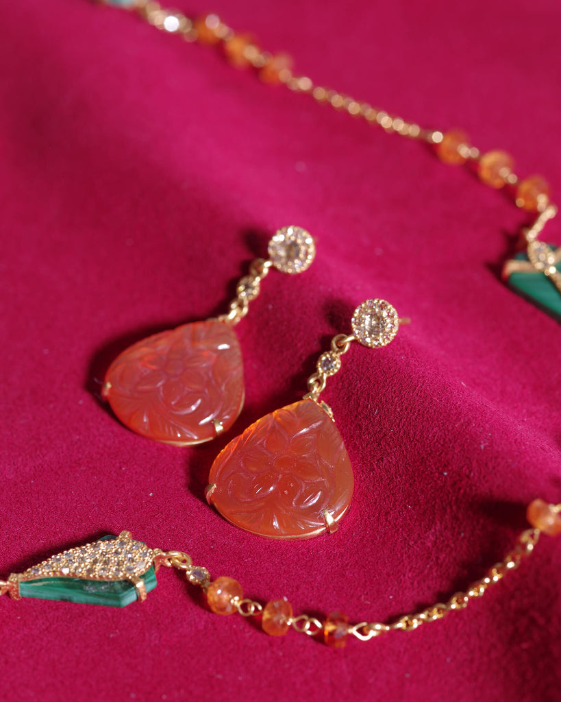 Hand-carved Carnelian Earrings, $1,950. product:20k-carved-carnelian-earrings