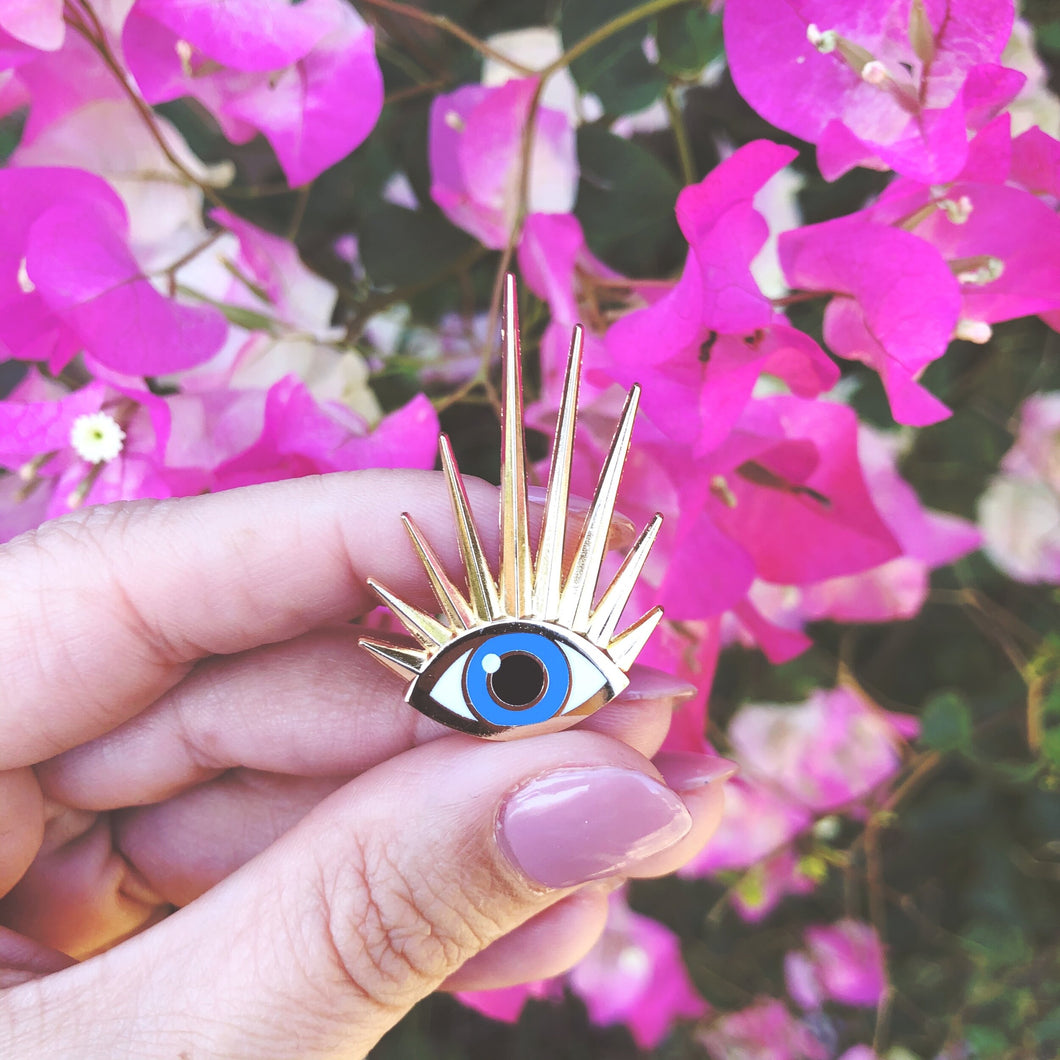 Eye M Golden enamel pin